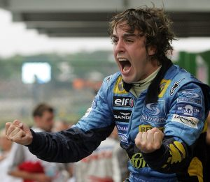 Spanish Formula One driver Fernando Alonso of Renault celebrates his World Champion title after arriving third in the Brazilian F1 GP, 25 September, 2005 at the Interlagos racetrack in Sao Paulo, Brazil. AFP PHOTO ANTONIO SCORZA